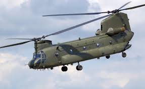 Chinook helicopter's blades must spin in opposite directions to keep the whole helicopter from spinning around.